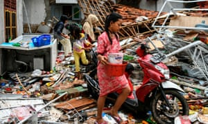Residents recover what they can from their homes following the deadly tsunami that hit off the Indonesian island of Java.