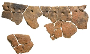 Fragments of a large early Neolithic bag-shaped round-bottomed vessel with finger impressions spaced below the rim.