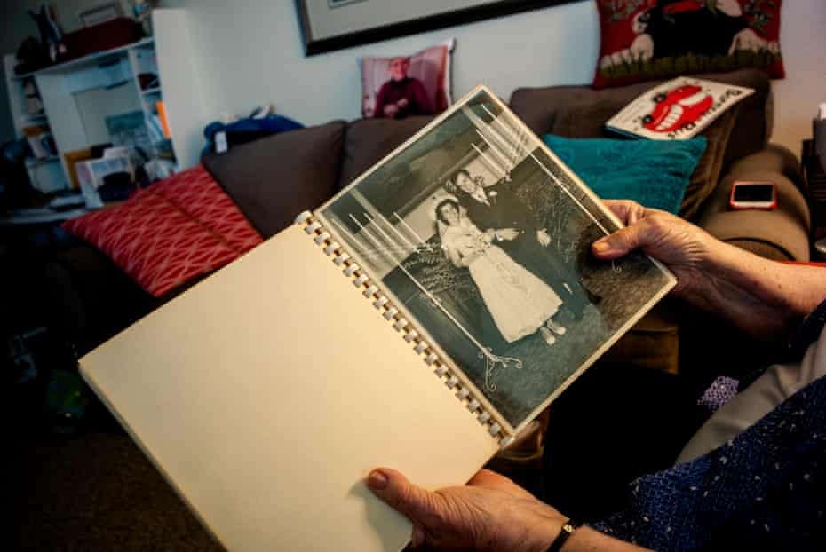 Juanita Erickson leafs through the album of her first wedding with her husband, who died in a small plane crash.