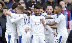 Leicester players celebrate after Riyad Mahrez, centre, gives them the lead in their victory over Crystal Palace at Selhurst Park on Saturday