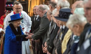The Queen distributes Maundy money at St George's Chapel, Windsor.
