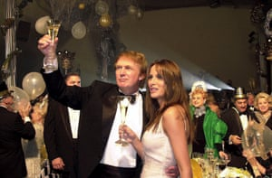 Trump and girlfriend Melania Knauss toast the new year during Trump's gala bash. Trump met Knauss in 1998 and they married in 2005. They have one son together, Barron