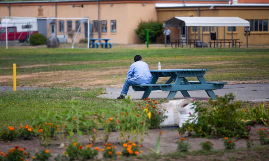 A resident sits on a bench. Civil confinement in Washington cost $185,136 per resident in 2018.