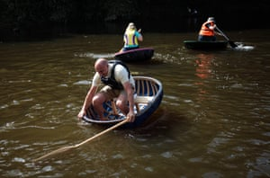 Coraclers take part in the Ironbridge Coracle Regatta on the River Severn