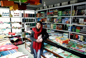A woman working in a Kabul bookshop