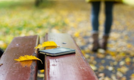 smart phone on a bench in park
