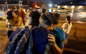 Two white women lead two black women in prayer at the site of last year's riots on the one year anniversary of the killing of Michael Brown in Ferguson