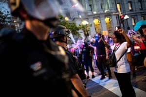 People face police during a protest in DenverPeople face police during a protest against the fatal injury inflicted by Minneapolis police on African-American man George Floyd, in Denver, Colorado, U.S. May 28, 2020. Picture taken May 28, 2020. REUTERS/Alyson McClaran