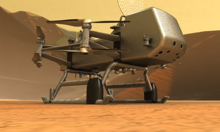 An artist's impression of Nasa's Dragonfly drone on the surface of Titan.
