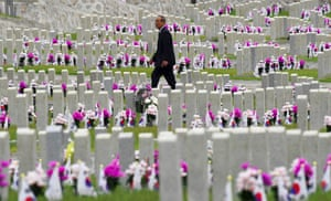 A man walks past graves during a ceremony to mark Korean Memorial Day at the National Cemetery in Seoul, South Korea
