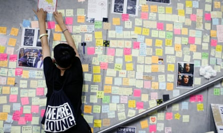 A poster is added to a wall of messages backing protests against the controversial extradition bill in Hong Kong.