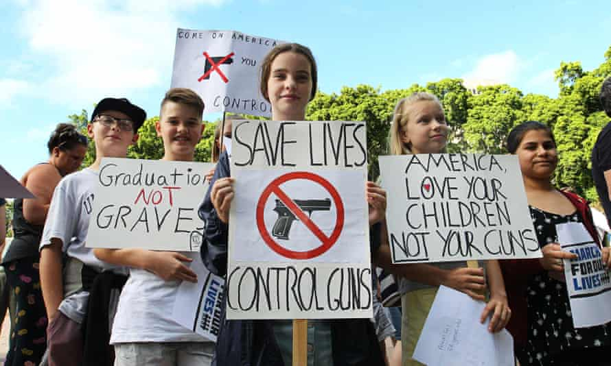 Protesters call for strict gun control in Sydney's Hyde Park on Saturday in a march to show solidarity with victims and survivors of US gun violence.