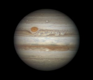 King of the Planets Damian Peach (UK) Looming in the night sky, tempestuous storms are visible across the face of the largest planet in our Solar System, Jupiter. The Great Red Spot - a raging storm akin to a hurricane on Earth - stands out in a deep orange from the hues of browns surrounding it.