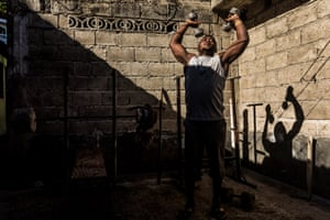 A man works out at one of the makeshift gyms inside Jalousie