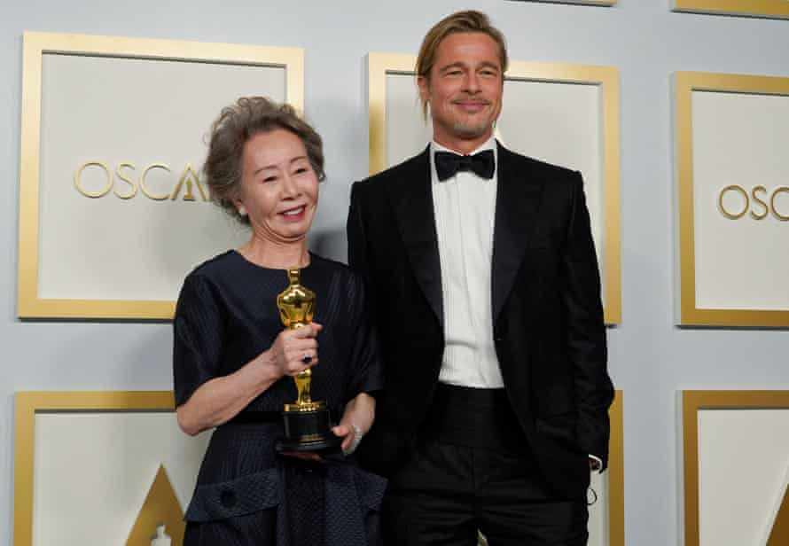 Youn Yuh-Jung with Brad Pitt, who announced her best supporting actress win.