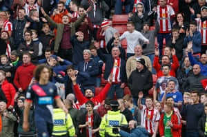 Sunderland fans wave goodbye to Coloccini after he is sent off.