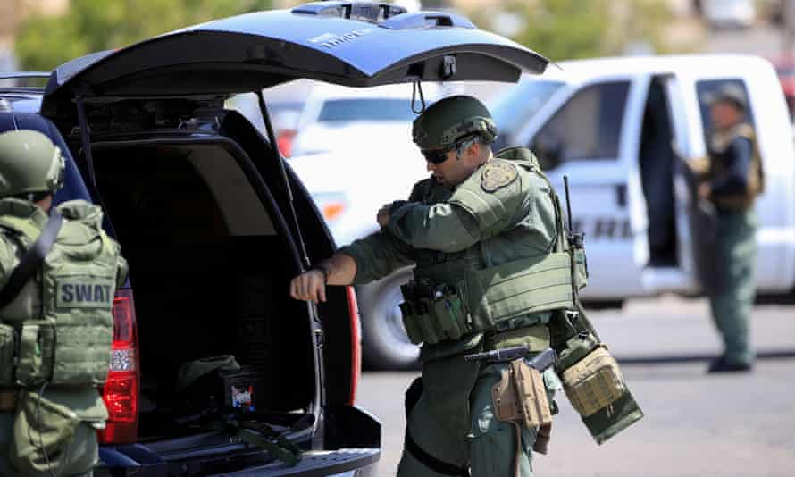 Police SWAT team members in the aftermath of a mass shooting at a Walmart in El Paso, Texas