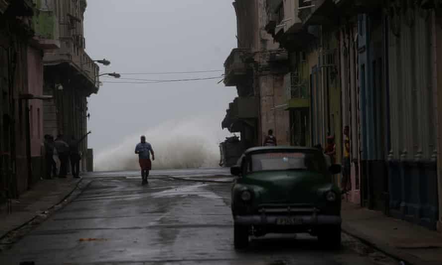A man stands in a flooded Havana street as Hurricane Irma hits Cuba.