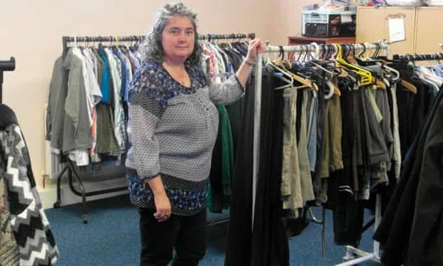Louise Cooke of Sharewear clothes bank next to clothes rails