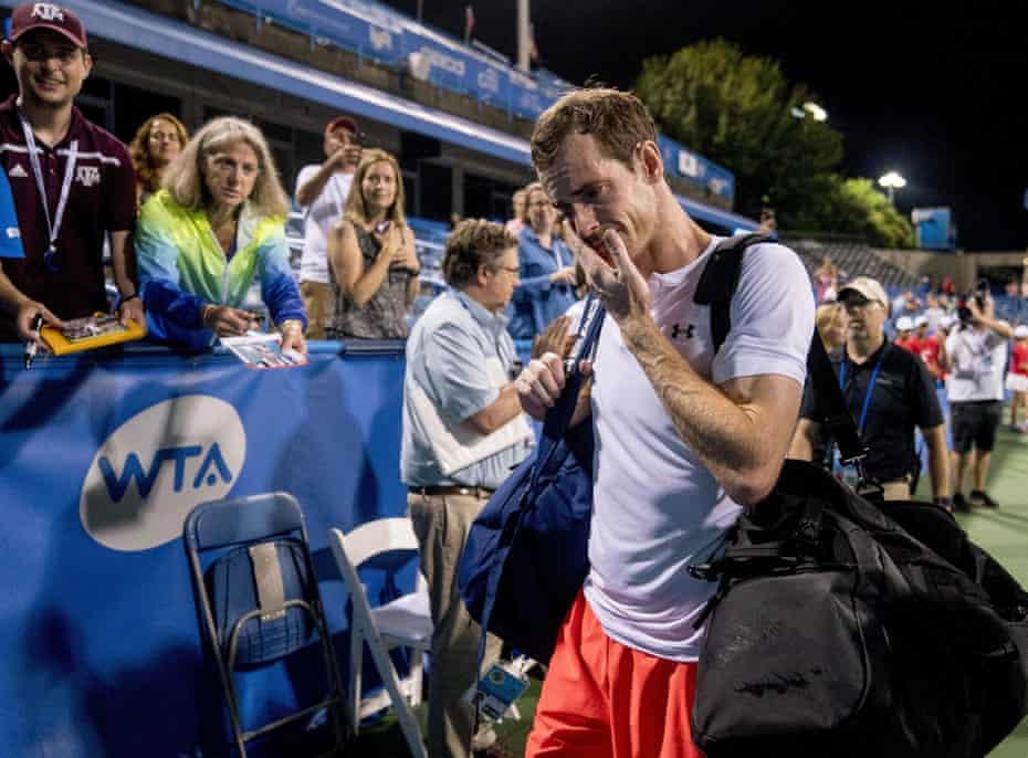An emotional Andy Murray, of Britain, steps off court after defeating Marius Copil, of Romania, 6-7 (5), 3-6, 7-6 (4), during the Citi Open tennis tournament in Washington, Friday, Aug. 3, 2018
