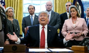 Donald Trump talks to reporters during a bill-signing ceremony in the Oval Office of the White House.