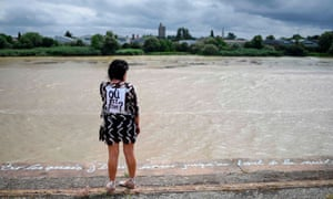 A woman looks out to the Loire river during a gathering to pay homage to Steve Canico.