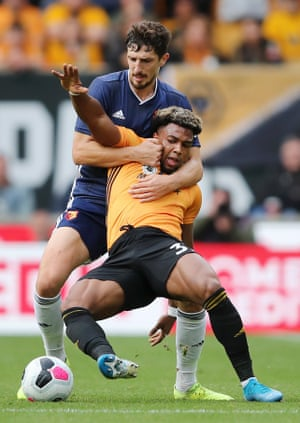 Romain Saiss of Wolves is challenged by Craig Cathcart of Watford during Wolves' 2-0 win.