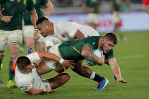 South African hooker Malcolm Marx bursts through the tackles of Henry Slade and Manu Tuilagi.