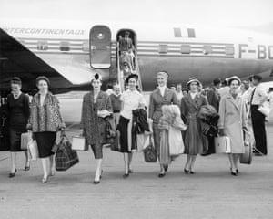 Christian Dior models arriving in Australia for the presentation of the autumn−winter 1957 haute couture collection, Christian Dior's last collection, at Myer Mural Hallin Australia, November 1957