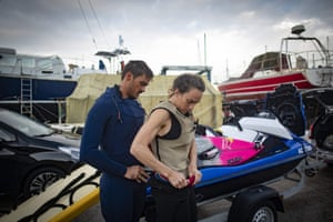 Dupont adjusts her airbag vest with the help of her boyfriend and jetski driver Fred David.