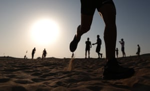 Participants in action during the Al Marmoom dune run 2020 in United Arab Emirates