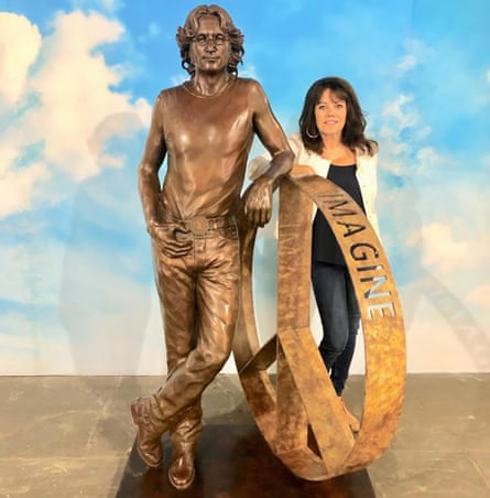 Laura Lian is seen with her John Lennon statue