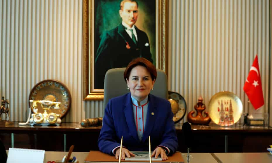 Meral Aksener sits in front of a portrait of the founder of the Turkish republic, Mustafa Kemal Ataturk, in the Ankara headquarters of her İyi (Good) party