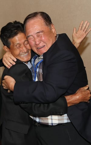 Emotional family reunion after six decades South Korea's Ham Seong-chan (R), 93, embraces his 79-year-old younger brother Ham dong-chan.