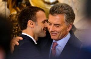 Emmanuel Macron hugs his Argentine counterpart Mauricio Macri during a press conference at Casa Rosada