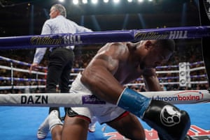 Joshua lands in the ropes after being knocked down for a second time in the third round.
