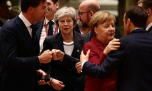 Theresa May looks on as Dutch prime minister Mark Rutte, far left, and German chancellor Angela Merkel and French president Emmanuel Macron greet one another at an EU meeting in December.