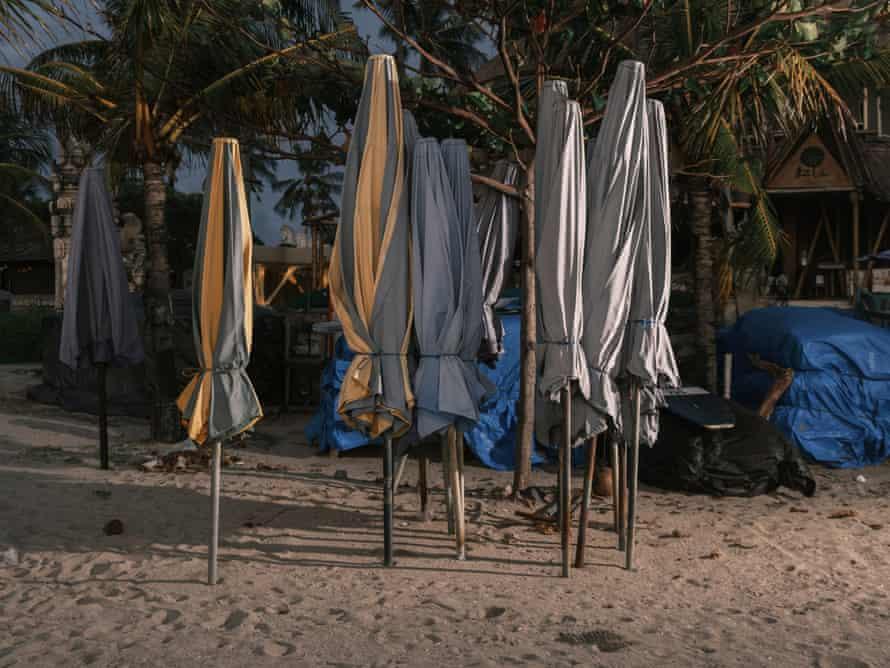 Closed parasols on a beach in Kuta