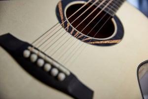 A close-up of a guitar sound hole