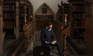 The keeper of the muniments, Matthew Payne, holding the manuscript in the Westminster Abbey library.