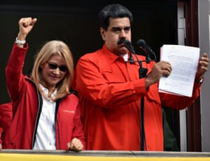 Nicolas Maduro speaks to a crowd of supporters flanked by his wife Cilia Flores to announce his government is breaking off diplomatic ties with the United States.