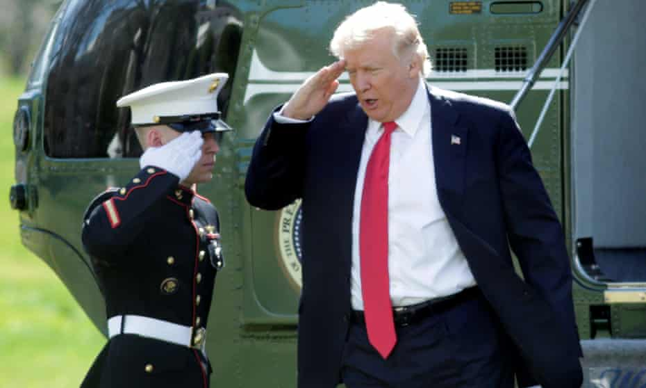 President Donald Trump salutes from the steps of the Marine One helicopter, in Washington.