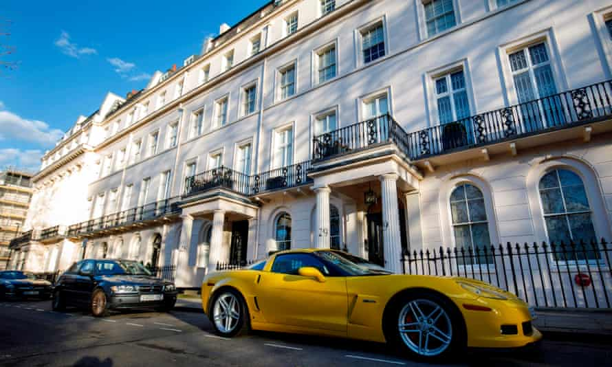 Cars and houses in Eaton Square, London