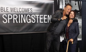 Bruce Springsteen, left, greets a fan at the launch of his autobiography at the Barnes & Noble in the New Jersey town where he grew up.