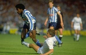 Gary Mabbutt (right) of Tottenham Hotspur tackles Dave Bennett of Coventry.