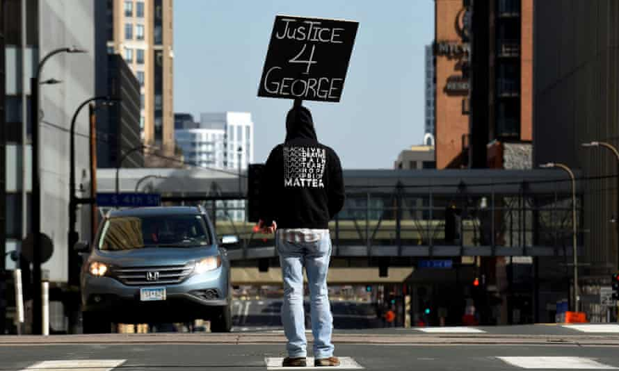 A demonstrator outside the Hennepin county government center in Minneapolis, Minnesota Monday.
