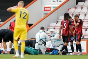 Bournemouth's Adam Smith lies on the turf and receives treatment after receiving a head injury.