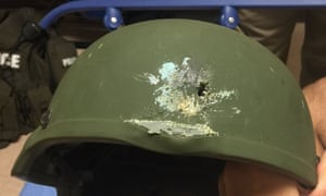 A bullet hole left in a Kevlar helmet worn by the Orlando police officer.