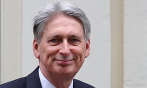 Philip Hammond leaves Downing Street to deliver the spring statement.