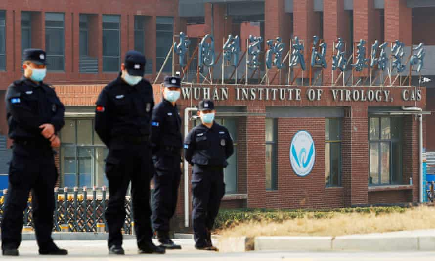 Security officers outside Wuhan Institute of Virology during the WHO visit in February.